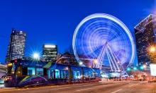 The Atlanta Streetcar and the Skyview Atlanta Ferris Wheel at blue hour.