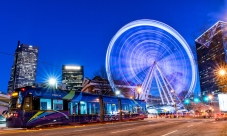 The Atlanta Streetcar and the Skyview Atlanta Ferris Wheel at blue hour.